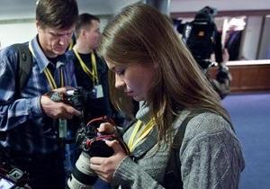 По примеру Путина: Личным фотографом президента РФ впервые стала женщина