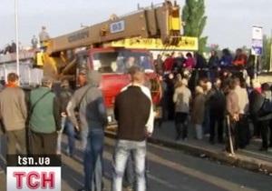 Попов заявил, что киоски на рынке Лесной в Киеве сносят законно