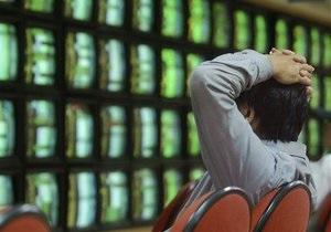 Рынки: Снижение рейтинга Португалии добавило напряженности