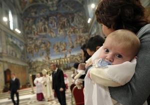 В католическом обряде крещения изменили слова  христианское сообщество  на  Божья Церковь