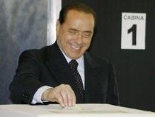 Exit-polls: Берлускони выигрывает выборы