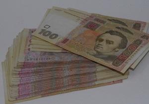 Гривна на межбанке упала к доллару до минимума за 14 месяцев