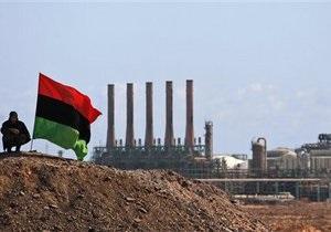 Противники и сторонники Каддафи ведут бой за стратегически важный нефтяной порт