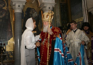 Вслед за Януковичем в молитве за Украину приняла участие и Тимошенко