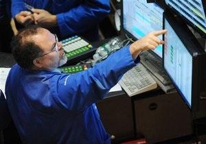 Рынки США закрылись снижением из-за слабых статданных