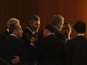 Участники саммита G8 выступили против протекционизма и девальвации валют