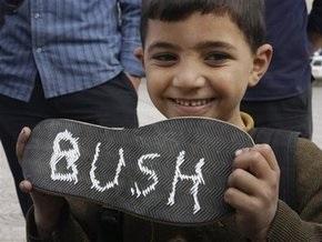 Буш назвал  ботинкометание  самым странным моментом своего президентства