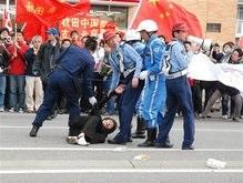 Япония агрессивно встретила Олимпийский огонь