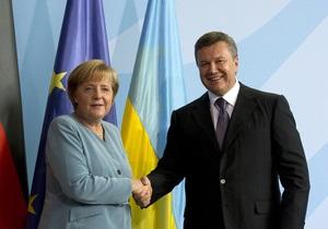 Меркель поговорила с Януковичем по-русски