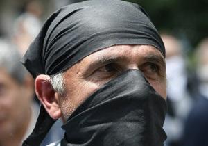 Почти ста участникам акций протеста в Грузии предъявили обвинения