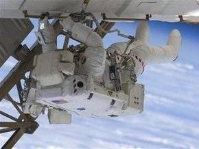 Астронавты Endeavour завершили четвертый выход в космос, который длился дольше обычного