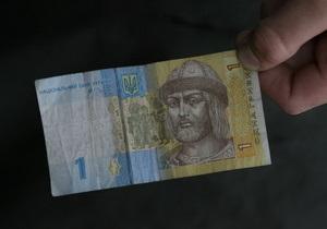 Азаров считает причиной падения курса гривны спекуляции банков
