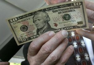 Гривна вновь незначительно выросла к доллару на межбанке