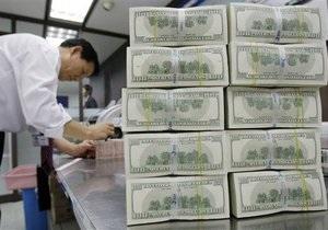 Китай намерен диверсифицировать золотовалютные запасы