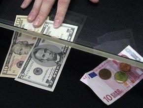 Евро растет к доллару на фоне роста мировых фондовых рынков