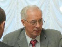 Азаров рассказал, когда средняя зарплата достигнет $1000