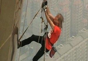 Француз Ален Робер покорил самый высокий стальной объект в мире