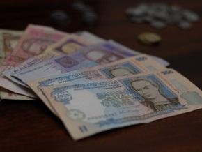 В Киеве при получении 130 тыс. гривен взятки задержаны двое чиновников