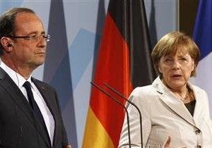 Олланд и Меркель прибыли на встречу в Реймсе