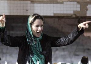 Дочь Каддафи добивается расследования гибели отца и брата