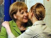 В Брюсселе Тимошенко целуется с Меркель. ПР проверяет, за чей счет