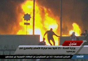 В Каире болельщики подожгли стадион. Число погибших в Порт-Саиде возросло до 50