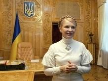 НГ: Путин поможет Тимошенко поднять рейтинг