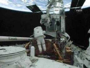Астронавты Atlantis завершили первый выход в открытый космос