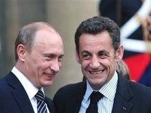 Саркози принял Путина в Елисейском дворце