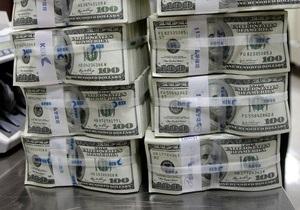 Гривна упала к 33-месячному минимуму по отношению к доллару