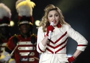 Элтон Джон назвал Мадонну ярмарочной стриптизершей