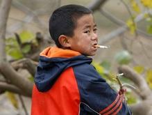 В Китае выросло количество курящих детей