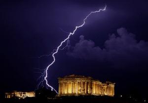 Греция близка к завершению сделки по списанию 68% долгов