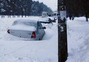 новости Киева - снег - наводнение - Из Киева за сутки вывезли более 14 тысяч тонн снега