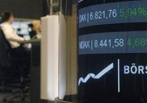 Обзор: Мировые фондовые индексы снизились, евро дорожает