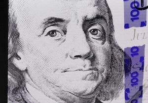 Спрос на доллары в Украине ограничит покупки облигаций минфина