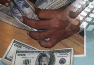 Двое киевлян получили более шести лет заключения с конфискацией за воровство $60 тыс. электронных денег
