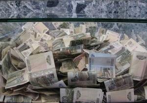 Межбанковский рынок закрылся незначительным понижением доллара в День Поминовения в США