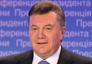 Янукович предложил журналисту помериться силами во многоборье