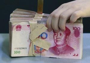 Курс юаня к доллару установил новый рекорд