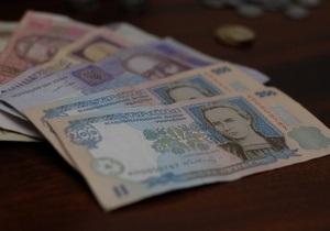 Более половины депозитов украинцы открывают в гривне