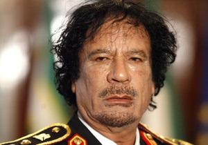 СМИ: В Каддафи стреляли из девятимиллиметрового оружия