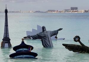 Активисты Greenpeace  утопили  Биг Бен и Эйфелеву башню