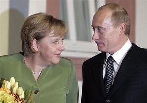 Путин - Меркель - Рейтинг Forbes