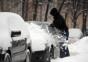 Фотогалерея: Белый четверг. Утренний снегопад парализовал Киев