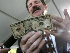 Доллар вырос к рублю до самого высокого уровня с лета 2006 года