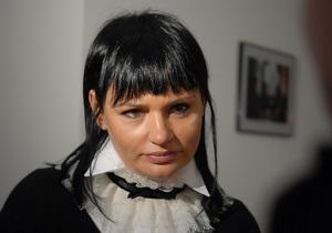 Кильчицкая развесила на балконах своей квартиры плакаты в поддержку Януковича