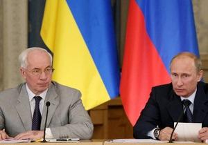 Путин наградил Азарова орденом