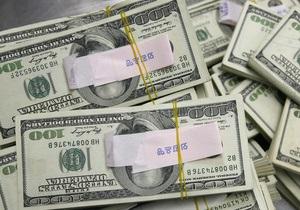 Курс доллара к главным валютам растет на опасениях за мировую экономику