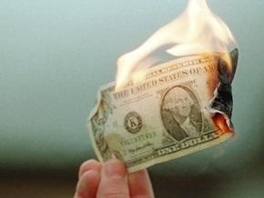 Нафтогаз не может купить доллары для выплаты долгов за газ